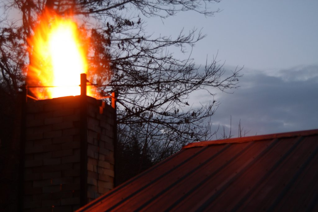 fire coming out of the wood-fired kiln chimney