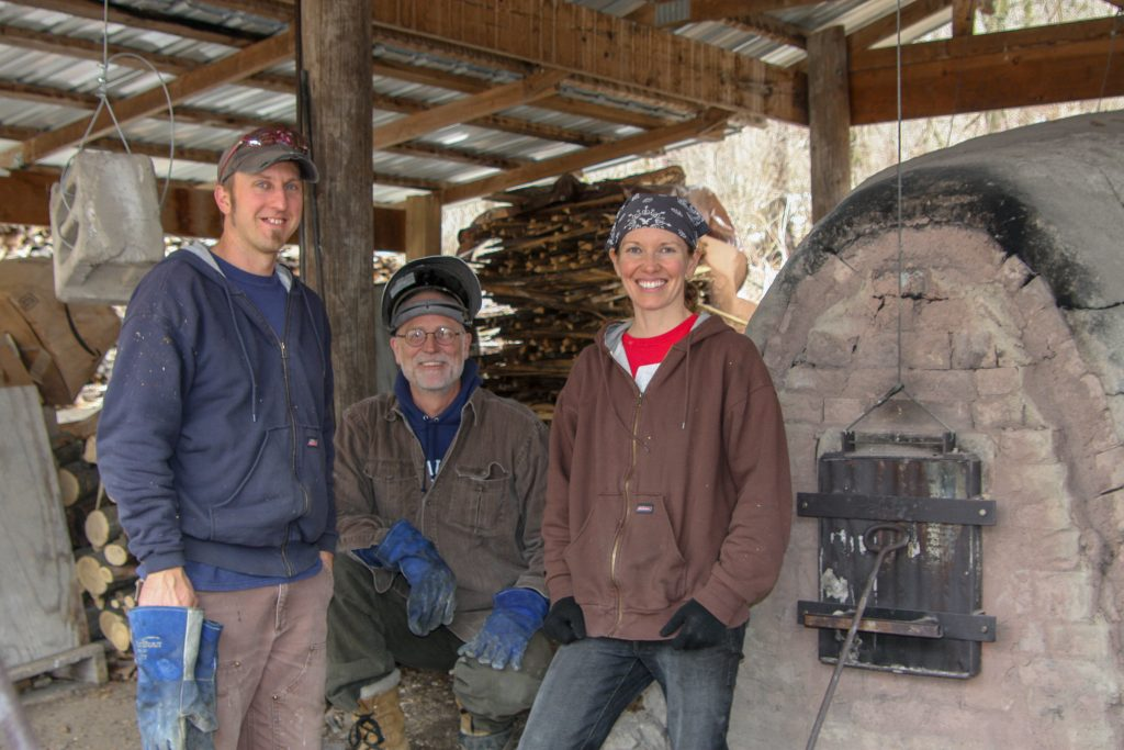 potters by the wood-fired kiln