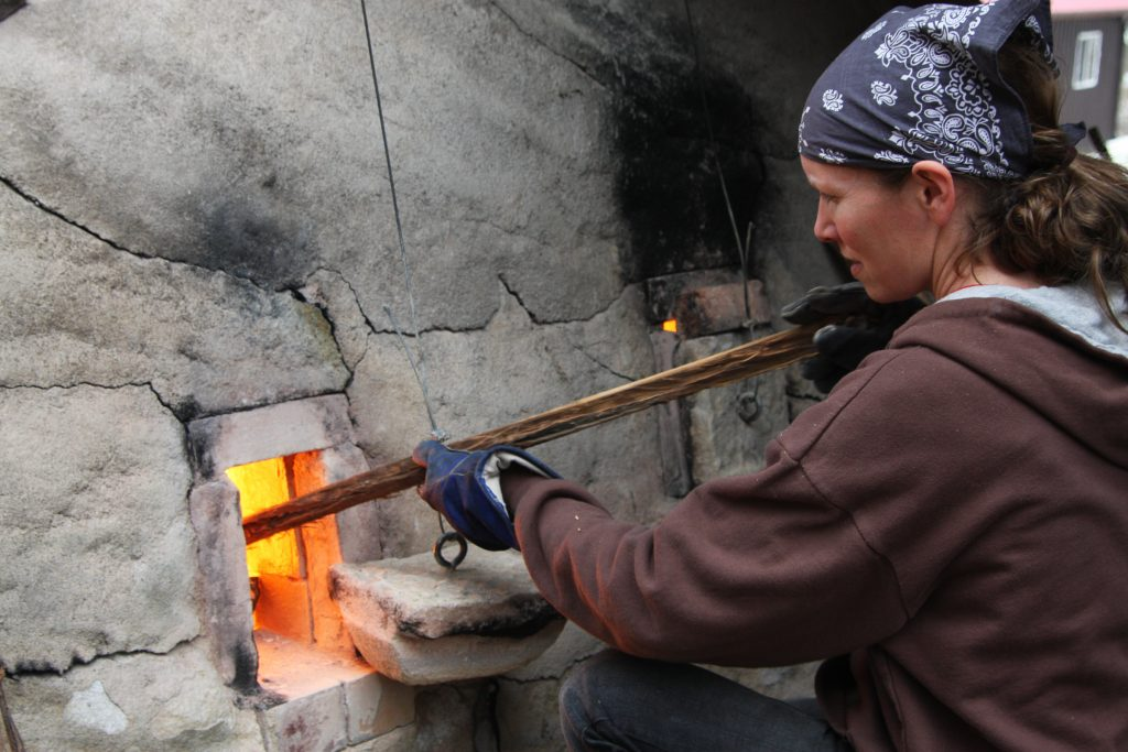 tending the wood-fired kiln