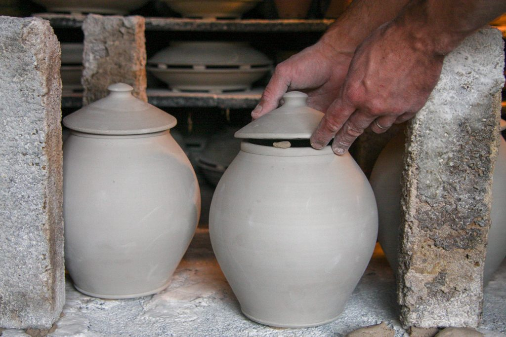loading the wood-fired kiln with pottery