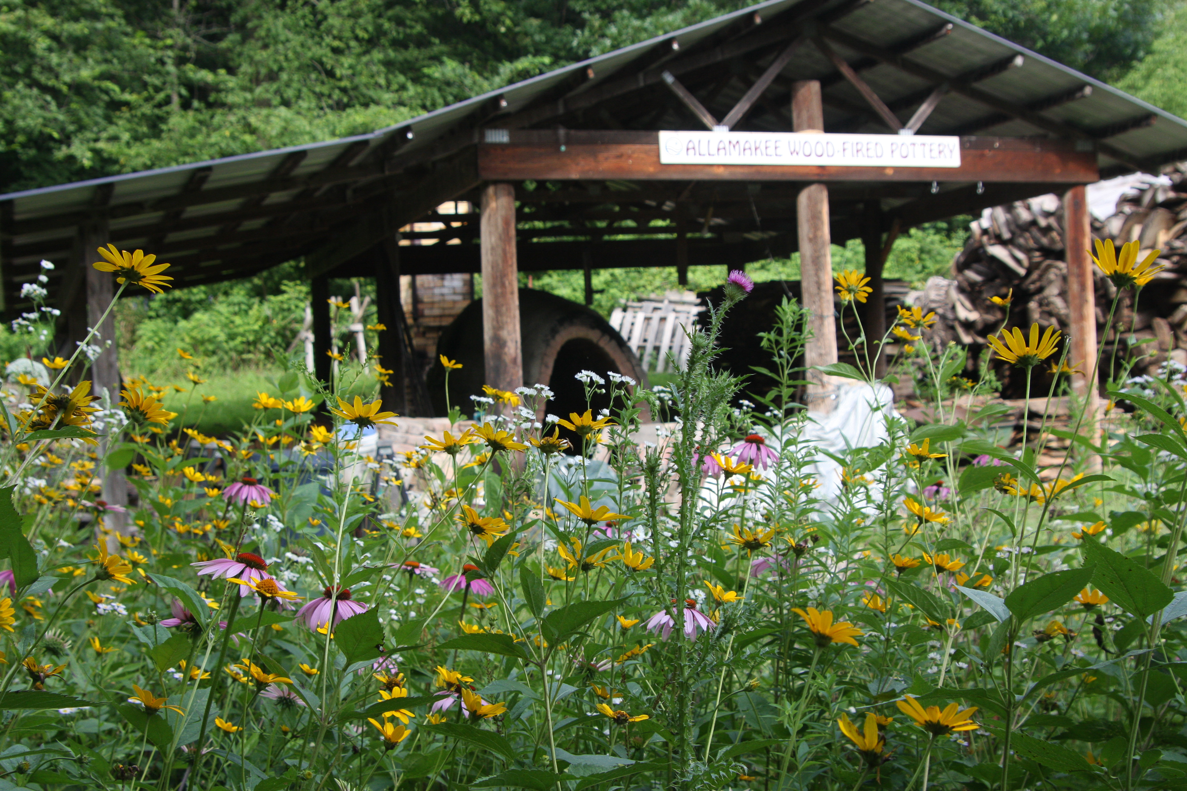 wood-fired kiln and wildflowers